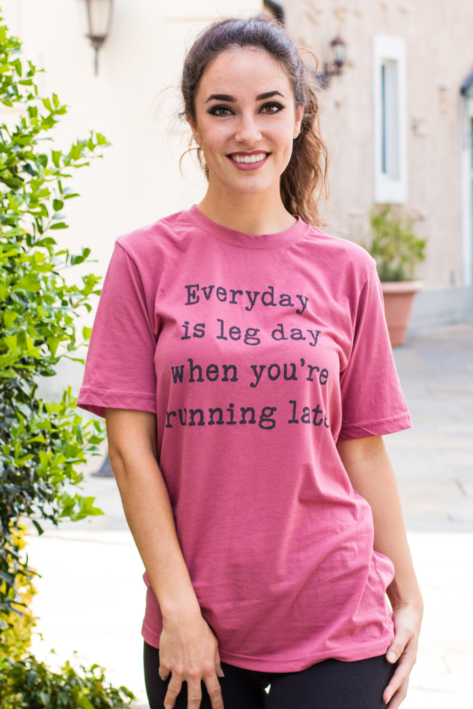 "Women's Ady Belle ""Everyday is leg day when you're running late"" hot pink tee."
