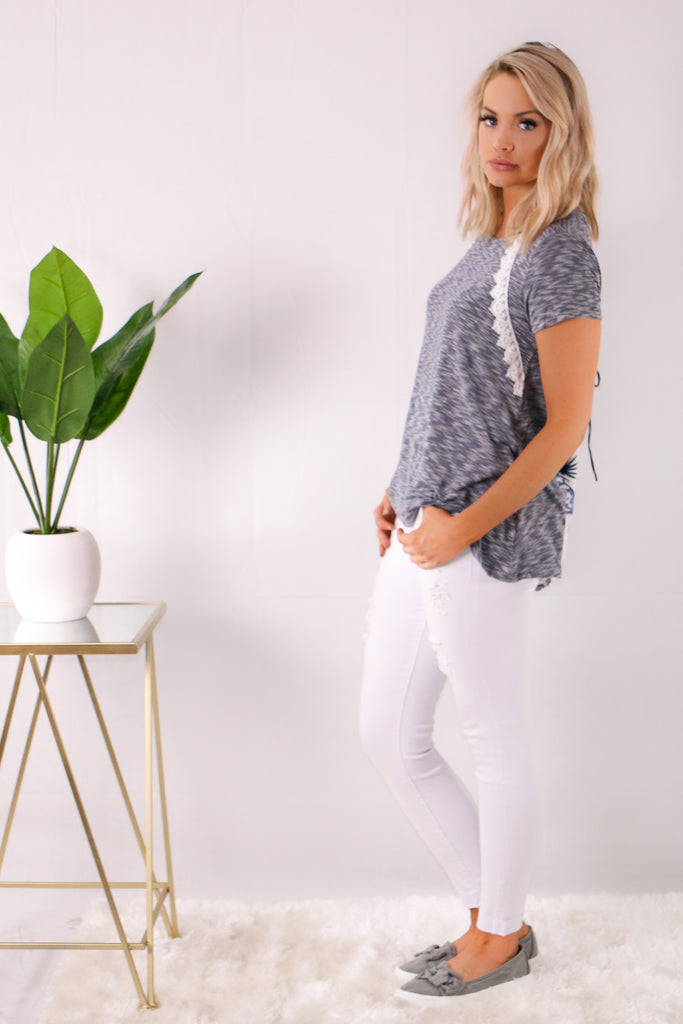 Gray Short Sleeve Lace Detail Top with White Skinny Jeans Side View