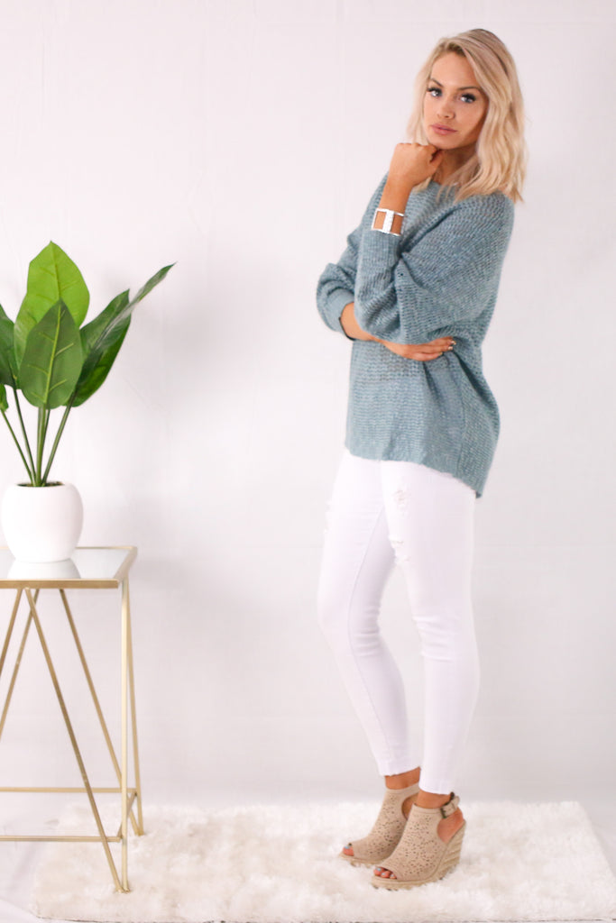 Destroyed White Skinny Jeans with Teal Sweatshirt