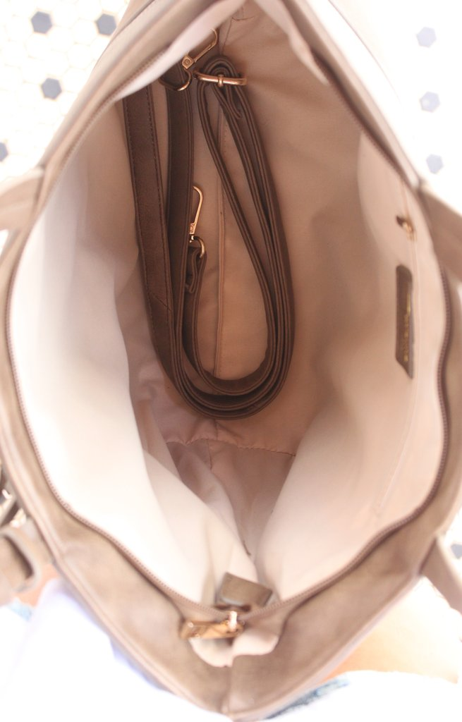 Roomy inside of suede tote purse with inner zip pocket and removable crossbody strap