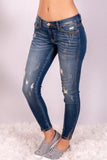 Medium Wash Split Hem Skinny Jeans with Distressed Detail Front Left View