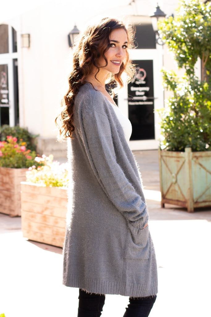 Grey Fuzzy Mid-Length Cardigan with Pockets Over the Shoulder Close Up