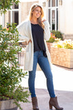 White Fuzzy Mid-length Cardigan with Pockets Front View (Hand on Hip)