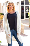 White Fuzzy Mid-length Cardigan with Pockets Front Close Up Hands in Pockets