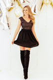 black fit and flare skater dress with side cutouts and over the knee boots outfit, fit and flare party dress with over the knee boots, new years dress