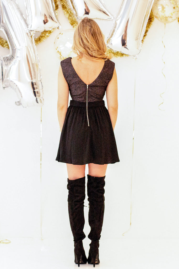 womens black fit and flare party dress with exposed zipper and over the knee boots outfit