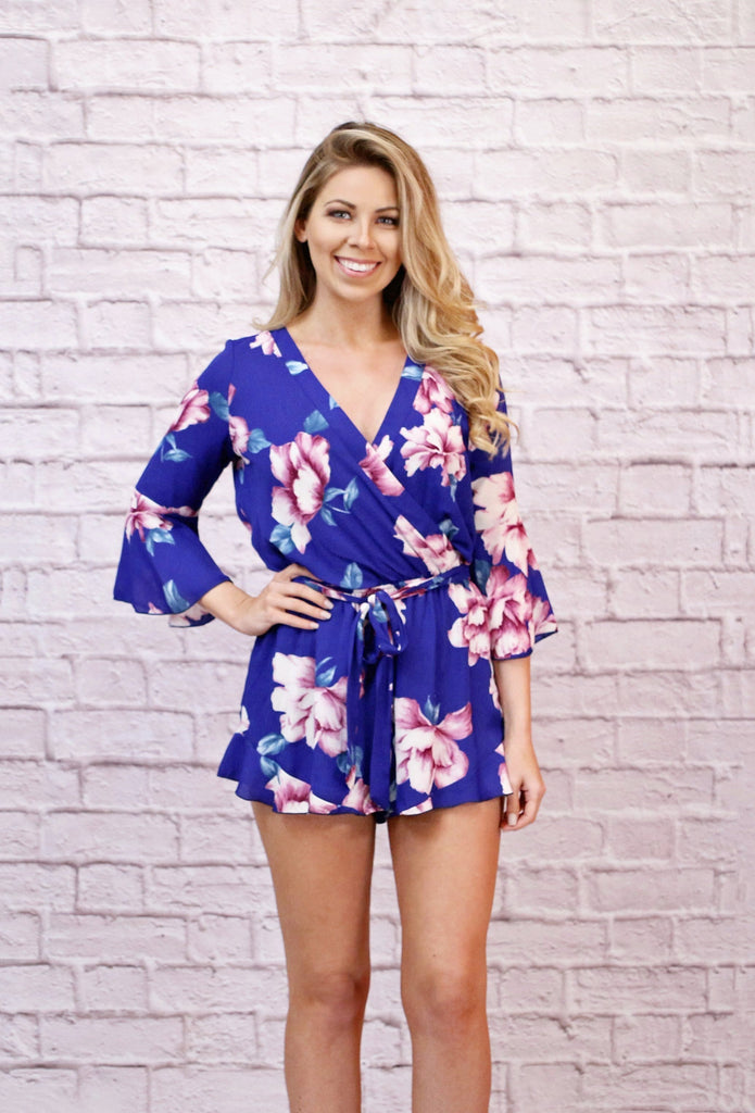 blue and pink floral romper with bell sleeves and ruffle shorts women's