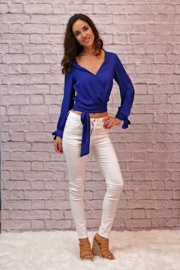 Blue V-Neck Wrap Front Long Sleeve Crop Top With Tie Waist and Sleeves, White Pants, and Wedges