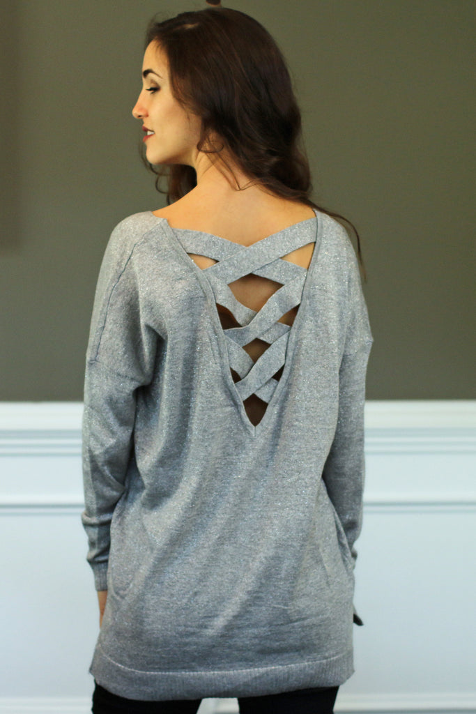 Back view of women's silver/grey criss-cross back pullover sweater