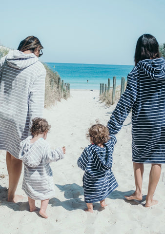 Mama and mini matching wearing swoodi adult and kid's zip up hooded towels and beach robe