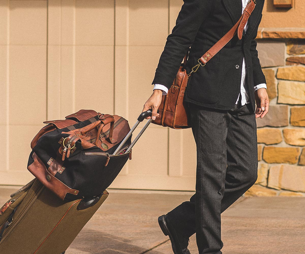 With the integrated trolley sleeve and a leather luggage tag that can be  monogrammed for free, it really is the perfect travel duffle. 56987e8cae