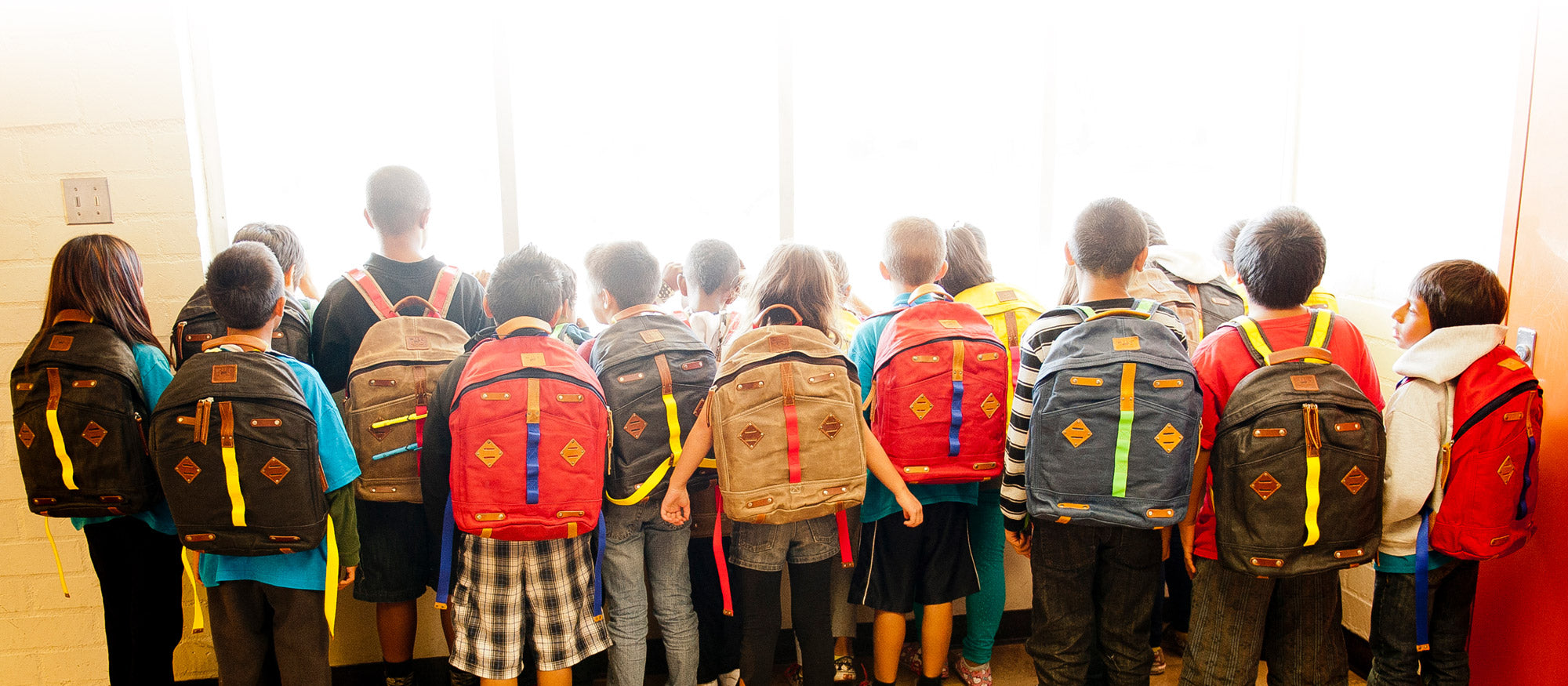Children with Give Will Backpacks