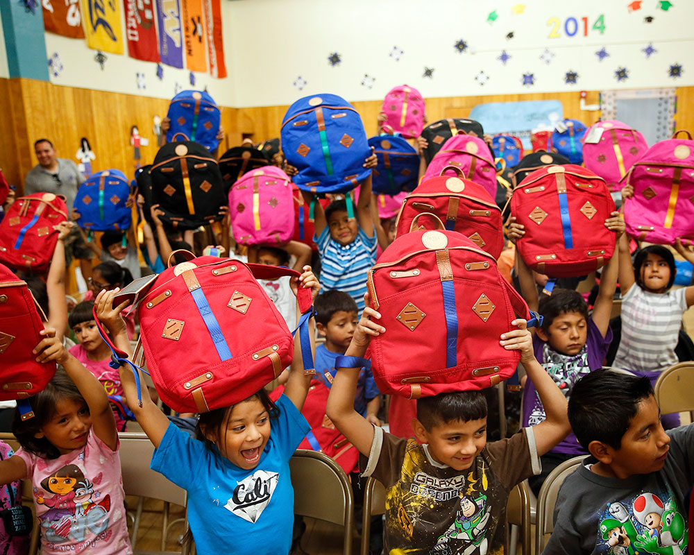 Kids in Classroom with Give Will Bags