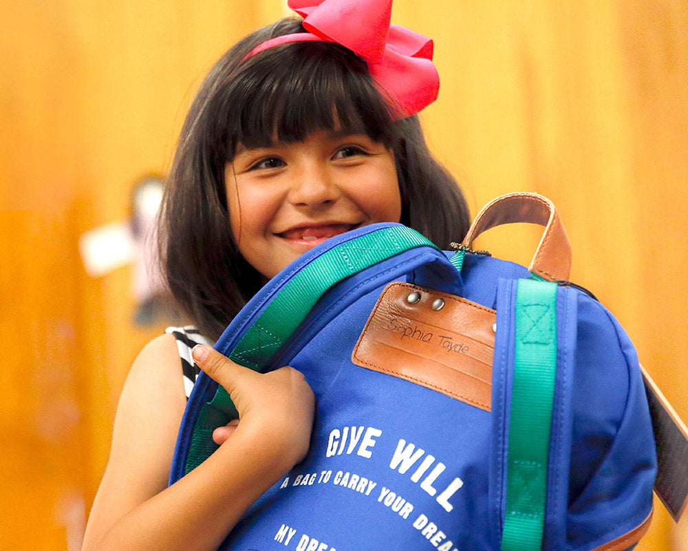 Sophia Holding Her Give Will Bag