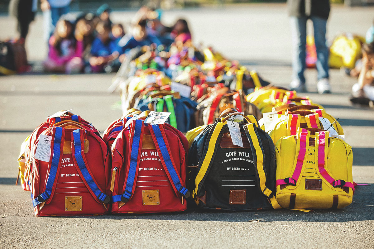 a group of give will backpacks