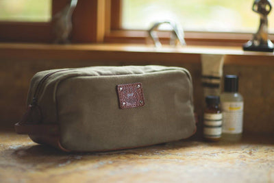 Olive Grady Travel Kit on bathroom counter