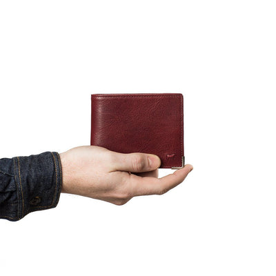 Hand Holding Wine Colored William Magnater Leather Wallet