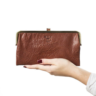 Hand holding Cognac Her Frame Clutch