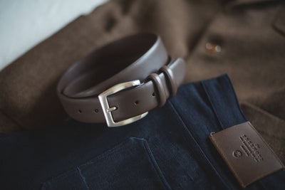 Artisan Belt Buckle Rolled Up on Folded Jeans