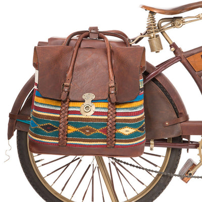 bike wheel with brown oaxacan backpack