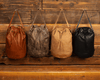MALMO - All Weather Leather Drawstring Backpack - PRESALE Backpack Monreaux