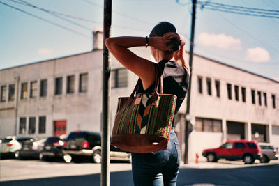 Woman in City Carrying Oaxacan Tote on her Shoulder