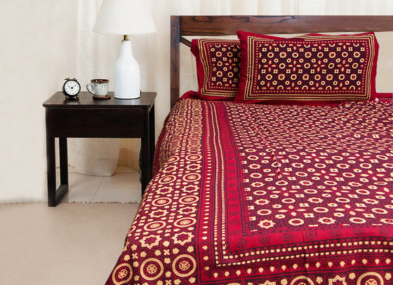 Small print maroon cotton bed sheet