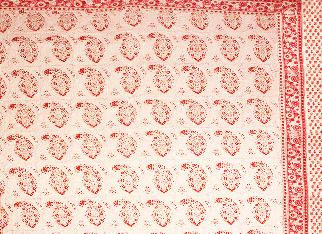 Red block printed bed sheet