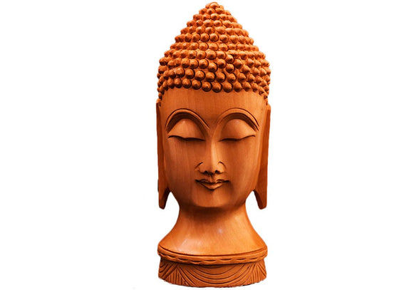 Carved wooden Buddha face