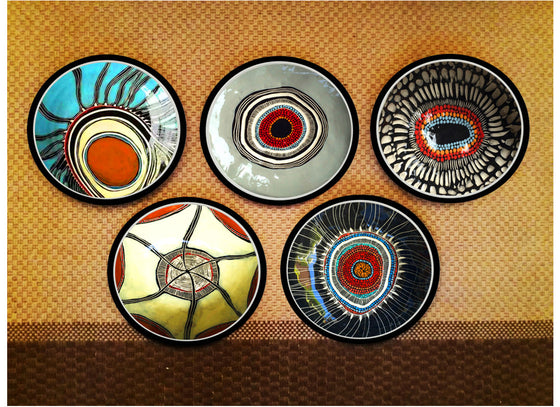 Hand-painted Aboriginal wall plates