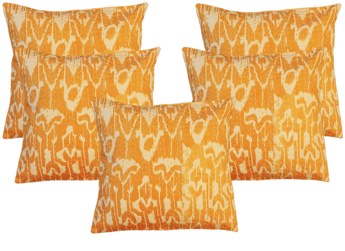 Orange abrak print cushion covers