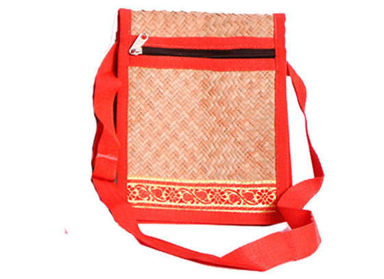 Red hand woven cane sling bag