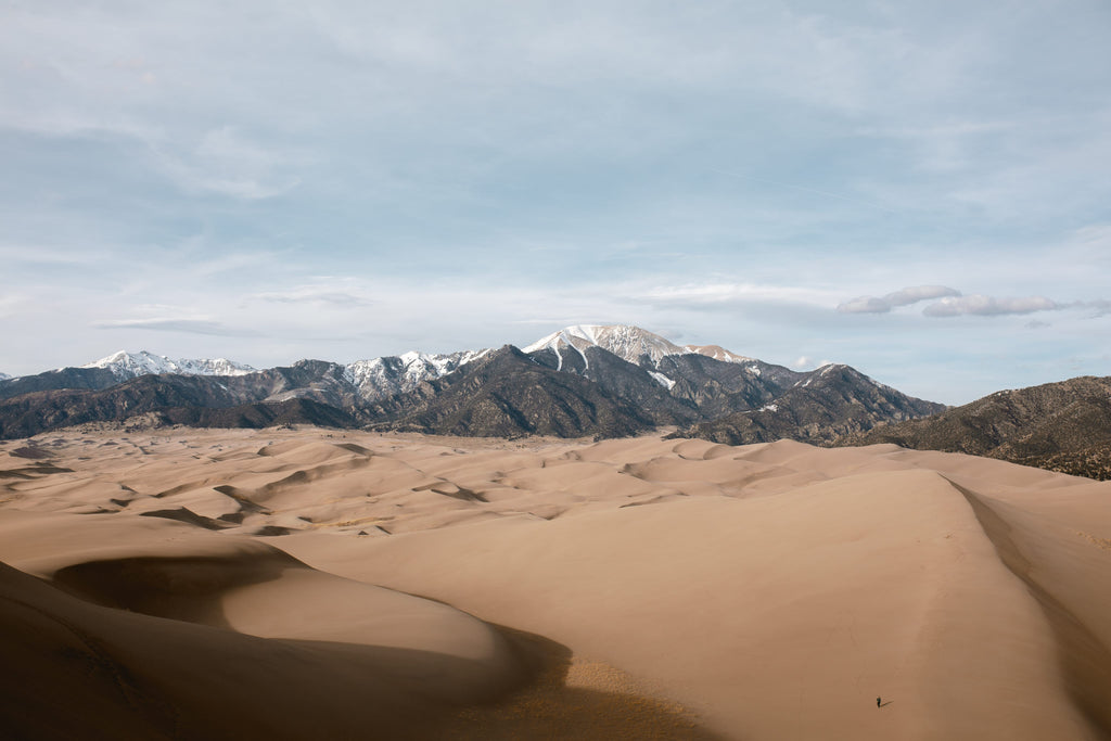 Picture of the Great Sand Dunes National Park with Colorado mountains in the background