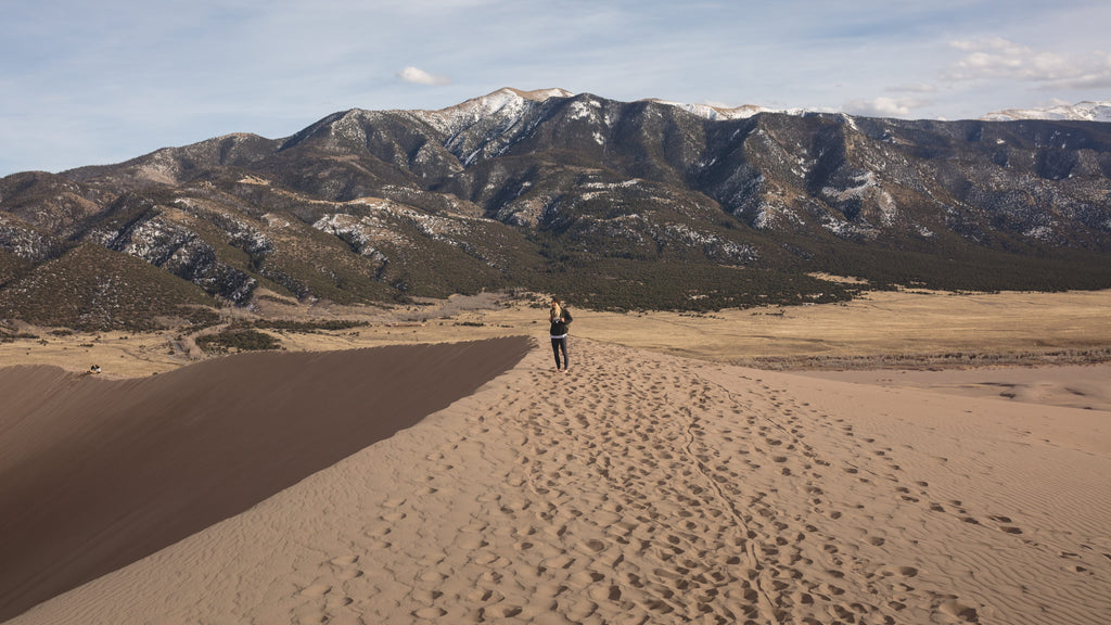 Girl walking through the Great Sand Dunes National Park