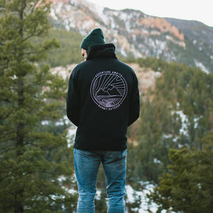 Back view of male model wearing a black Summit Outdoor Ridgeline hoodie