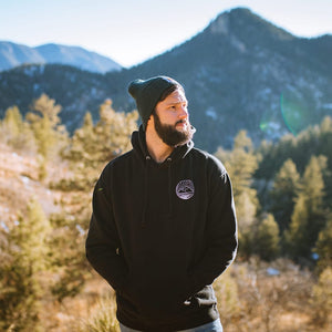 Front view of male model wearing a black Summit Outdoor Ridgeline hoodie