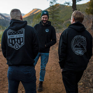 Group of men wearing Summit Outdoor hoodies while hiking