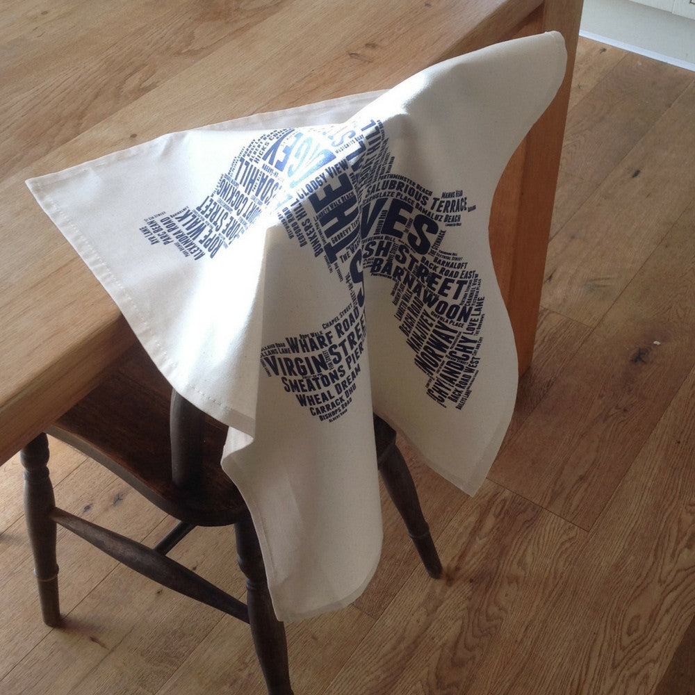 st ives seagull street name tea towel cornwall blue on a chair in my kitchen