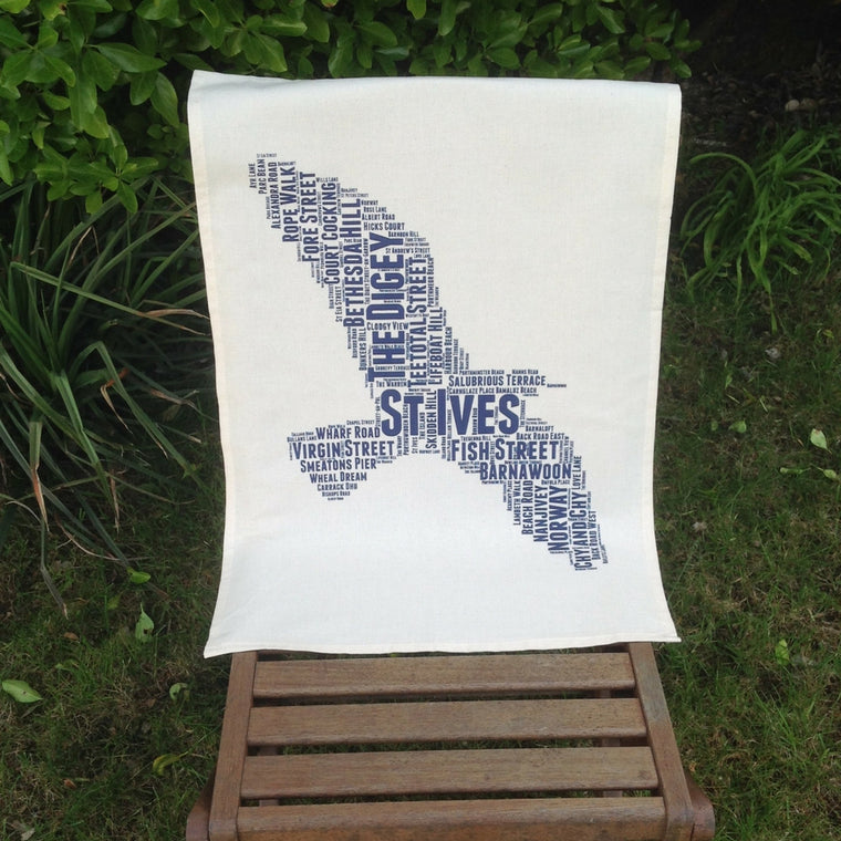 st ives seagull street name tea towel cornwall blue on a chair in my garden