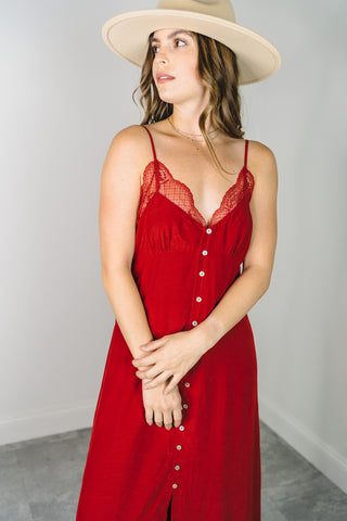 Woman wearing a red maxi slip dress