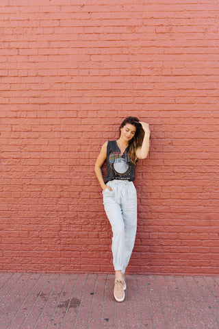 "Girl wearing a ""the band"" muscle tank with chambray high waisted joggers"