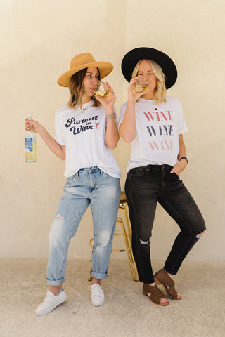Friends wearing graphic wine tees with boyfriend jeans.
