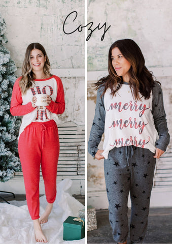 Two girls wearing Christmas pajama matching sets.