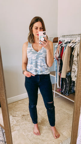 Woman wearing a camo zsupply skimmer tank top and black skinny denim