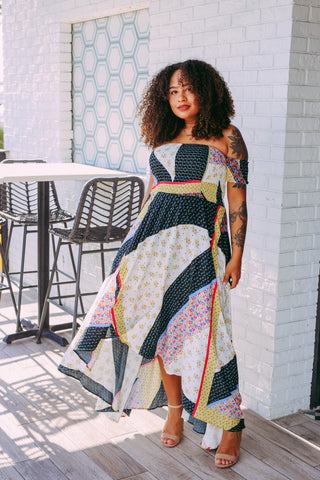 Woman wearing a patchwork maxi dress for fall 2020