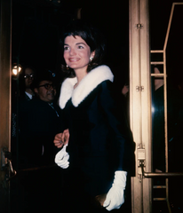 Jackie was all glamour in a fur ruff and matching evening gloves on a night out