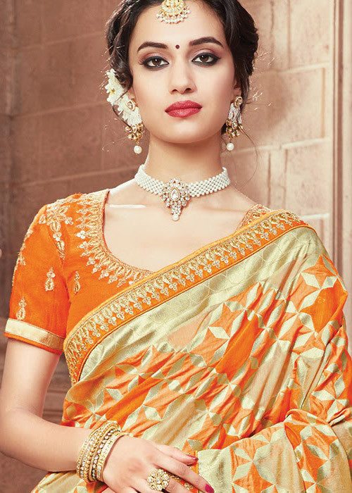 Orange Ikkat silk saree for women - Best price guranteed