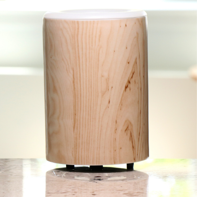 "Happy Wax Birch Wood Mod Wax Warmer - The Mod Wax Melt Warmer is the perfect way to fragrance your home flame-free! A built-in ceramic heater gently warms any scented wax melt, cube, or tart releasing your favorite fragrances in minutes! Looking for a wax warmer with a timer? The Mod Wax Melt Warmer also includes our ""no scrape"" silicone wax melt removal dish. Simply ""pop"" used wax right out of the dish to change scents in seconds. The Mod Wax Warmer features a 3-6-9 hour auto shut off timer."