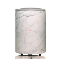 "Happy Wax Marble Mod Warmer - The Mod Wax Melt Warmer is the perfect way to fragrance your home flame-free! A built-in ceramic heater gently warms any scented wax melt, cube, or tart releasing your favorite fragrances in minutes! Looking for a wax warmer with a timer? The Mod Wax Melt Warmer also includes our ""no scrape"" silicone wax melt removal dish. Simply ""pop"" used wax right out of the dish to change scents in seconds. The Mod Wax Warmer features a 3-6-9 hour auto shut off timer."
