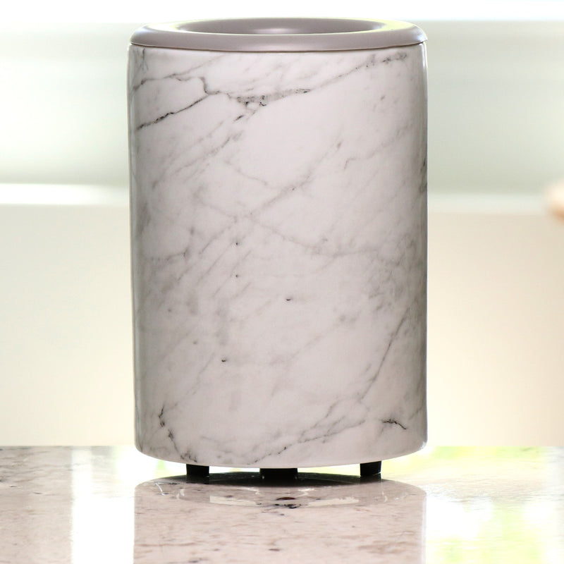 "Marble Mod Warmer - The Mod Wax Melt Warmer is the perfect way to fragrance your home flame-free! A built-in ceramic heater gently warms any scented wax melt, cube, or tart releasing your favorite fragrances in minutes! Looking for a wax warmer with a timer? The Mod Wax Melt Warmer also includes our ""no scrape"" silicone wax melt removal dish. Simply ""pop"" used wax right out of the dish to change scents in seconds. The Mod Wax Warmer features a 3-6-9 hour auto shut off timer."